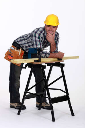 workmate: Carpenter leaning on work-mate Stock Photo