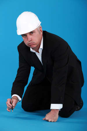 Bored architect writing on the floor Stock Photo - 14195461