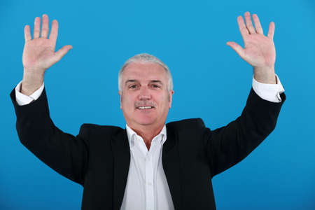 distinction: Businessman with his hands up