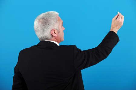 spokesman: Businessman with a piece of chalk Stock Photo