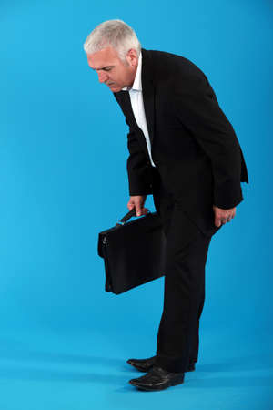 Middle-aged businessman with briefcase photo