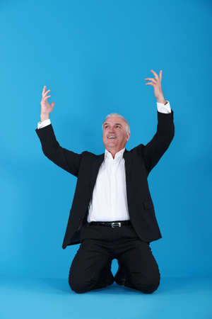 kneeling man: Businessman on his knees Stock Photo
