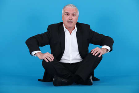knees bent: Elderly man sitting on the floor