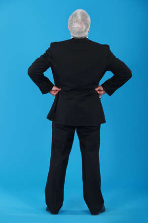 back view of senior man in a suit photo