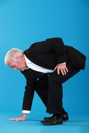 bending over: Man touching the floor