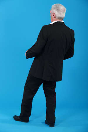 clumsy: Businessman leaning backwards
