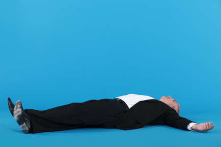 out of focus: Businessman laying on floor Stock Photo