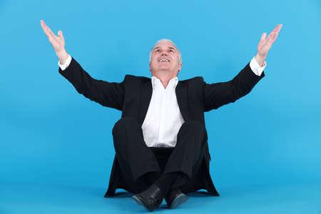 happy businessman thanking God photo