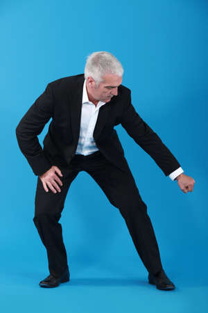 Businessman pulling an imaginary object photo