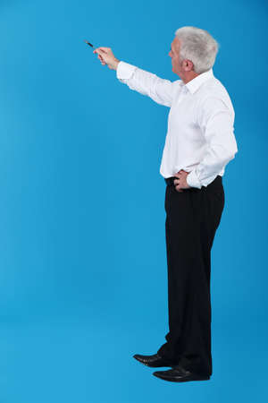 Man pointing to an invisible object photo