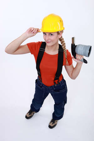 acknowledgment: craftswoman holding a welding torch Stock Photo