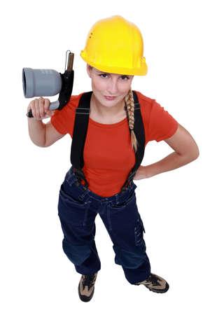 blowtorch: Female laborer holding blowtorch