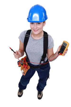 Woman electrician with multimeter photo
