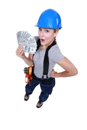 craftswoman: craftswoman holding bills