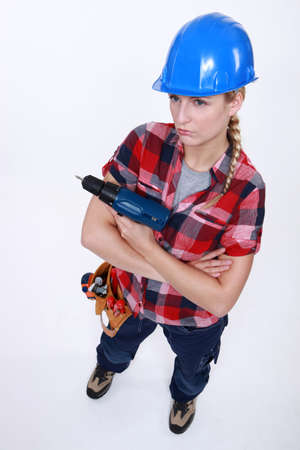 Grumpy female carpenter photo