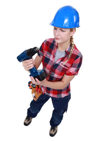Woman with a cordless power drill photo
