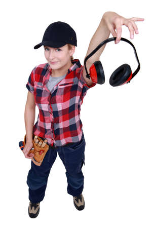 Female construction worker showing headphones photo