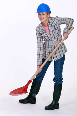 figure out: Woman using spade Stock Photo