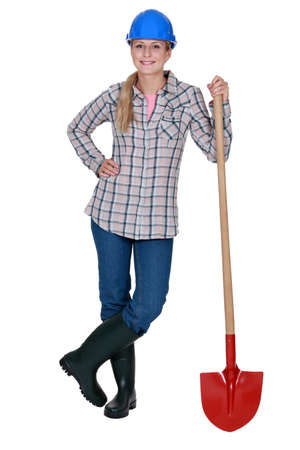 supported: Woman standing with shovel