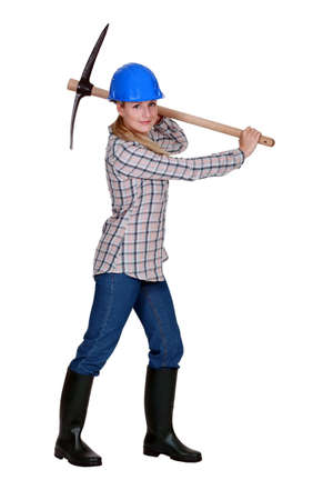 pickaxe: female bricklayer holding pickaxe
