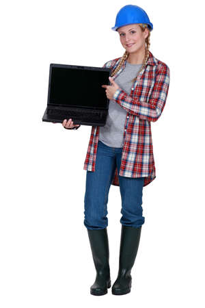 craftswoman: craftswoman posing with laptop Stock Photo