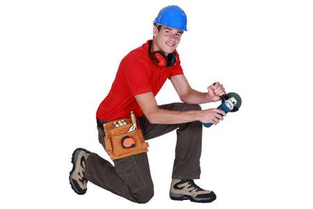 sander: Craftsman holding sander