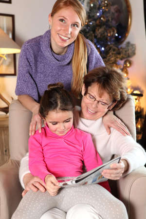three generations: Grandmother, mother and daughter at Christmas Stock Photo