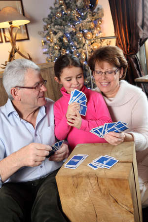 games hand: Family playing card game at Christmas