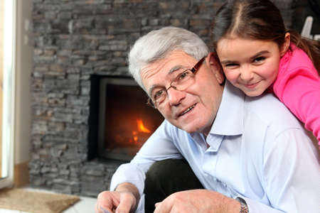 Grandfather and granddaughter playing Stock Photo - 14195154