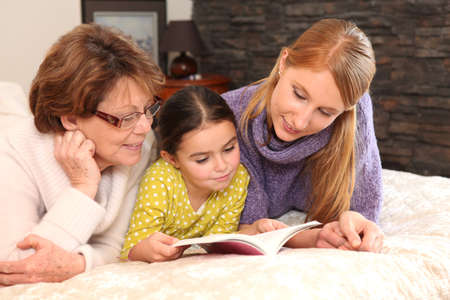 three generations: Three generations reading a book together