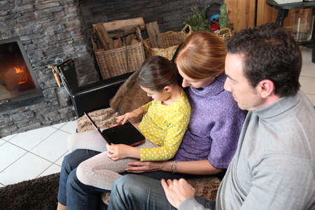 Young family watching film on laptop Stock Photo - 14195109