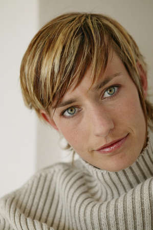 Blond woman wearing winter sweater photo
