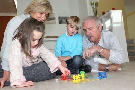 Elderly couple playing with their grandchildren photo