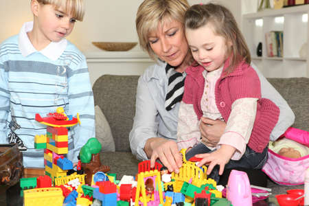 Mother and two children playing together Stock Photo - 14230162