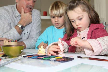 plaster of paris: Children painting plaster models
