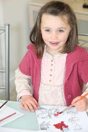 Little girl painting photo