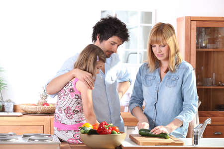 Young family in the kitchen photo