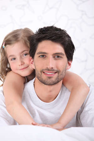parentage: Girl hugging father Stock Photo
