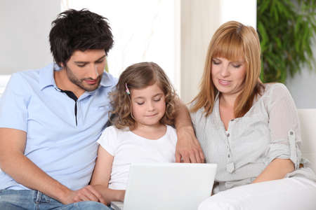 role model: Parents helping their child with her homework