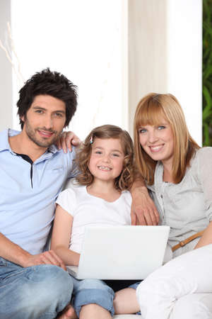 Family with a laptop photo
