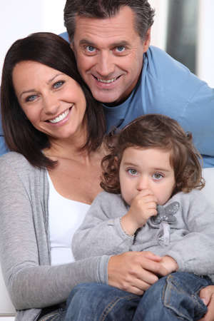 Smiling parents and their little girl Stock Photo - 14214882