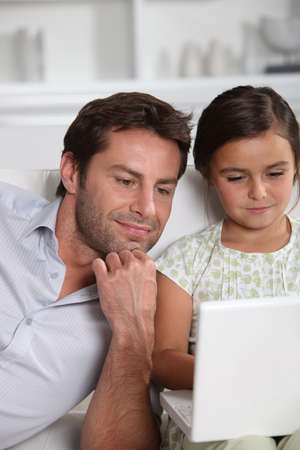 Father and daughter on the computer photo