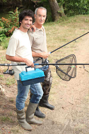 Father and son on fishing trip photo
