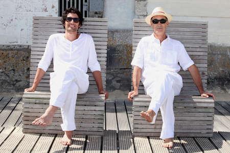 pies masculinos: Padre e hijo relajarse