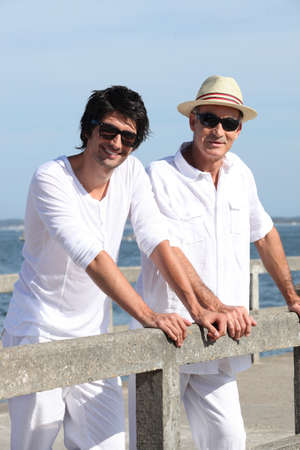 senior business man: Father and son stood at the pier Stock Photo