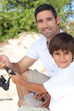 Father and son dishing photo