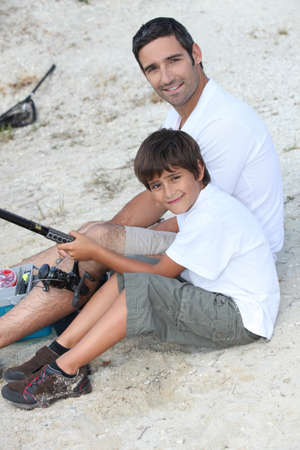 father and son at fishing party photo