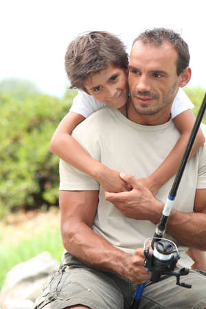 lake front: Father and son fishing Stock Photo