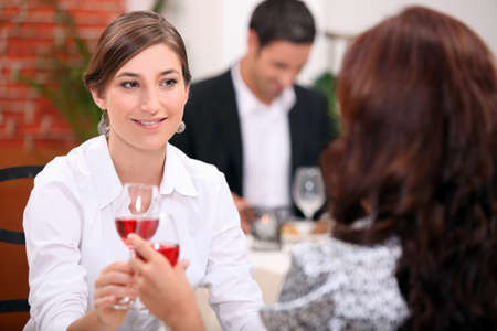 women drinking wine in a restaurant photo