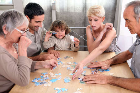 convivial: a family making a puzzle